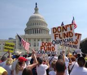 The road to a government shutdown began with demands by the Tea Party, expressed at this Sept. 10 rally at the Capitol, for Republicans to oppose any spending bill that doesn't defund health care reform.