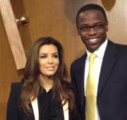 Eva Longoria poses for a picture with Senate aide Julius Niyonsaba