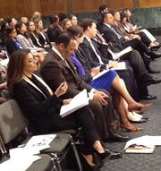 Eva Longoria, left, reviews her testimony before speaking to the Senate Small Business & Entrepreneurship Committee.