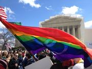 The gay rights flag flew in the breeze outside the U.S. Supreme Court.