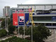 American flags blow in the wind ouside the Tampa Bay Times Forum, home of the convention.