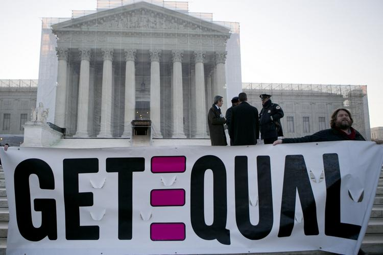 A supporter of gay marriage demonstrates outside the U.S. Supreme Court.