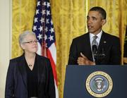 Gina McCarthy, left, was confirmed as Environmental Protection Agency administrator on a 59-40 vote.