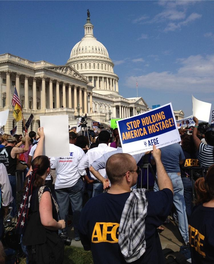 Federal employees rally outside the U.S. Capitol to protest the government shutdown.