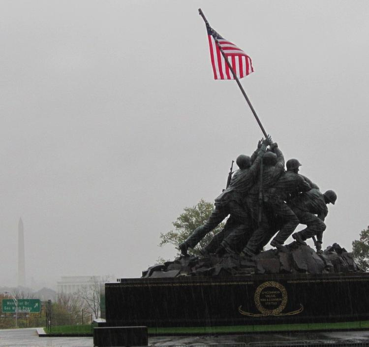 The Washington Monument and Lincoln Memorial could barely be seen today from the U.S. Marine Corps' Iwo Jima Memorial as Hurricane Sandy approached Washington, D.C.