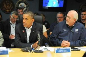 President Barack Obama discusses Hurricane Sandy response with FEMA Administrator Craig Fugate.