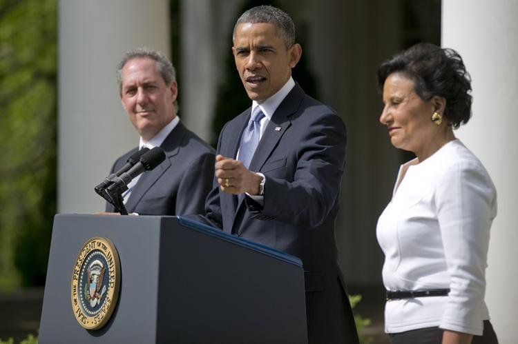 President Barack Obama announces his selection of Michael Froman, left, as U.S. trade representative, and Penny Pritzker, right, as Commerce secretary.