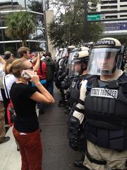 Police keep protesters Monday from marching toward the convention hall.