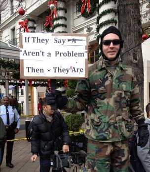 Protesters such as this one greeted the NRA at its press conference at the Willard InterContinental hotel in Washington, D.C.