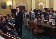 Lots of photographers and television crews were on hand to greet acting IRS Commissioner Steven Miller.