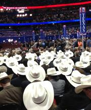 The Texas delegation shows they're good guys -- and gals -- by wearing white hats, cowboy hats, of course.