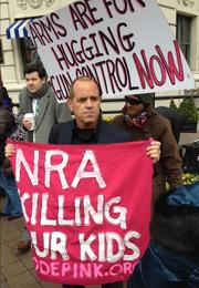 "Tighe Barry of Santa Monica, Calif., was one of the protesters who held up an anti-NRA sign inside the ballroom during the press conference. How did he get in? ""Code Pink magicry,"" he says."