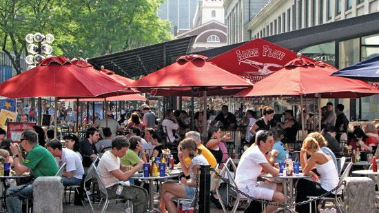 In Boston, bars and restaurants with outdoor patio seating tend to cluster in the Back Bay and Faneuil Hall (pictured). An interactive map shows every watering hole with an outdoor table in Boston, Brookline, Cambridge, Quincy and Somerville.