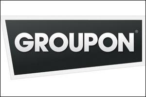 Groupon shares were trading down as the company struggles with marketing costs.