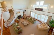 A view of the living room from the second floor at 260 Polpis Road on Nantucket. The main house on the compound was built in 2000.
