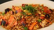 Hot dog challenge: Trina's Starlight Lounge in Cambridge: The salads, cocktails and burgers are heavenly, but the best part is that chef Suzi Maitland's creates a new gourmet hot dog daily. (Pictured: Dog fried rice.)