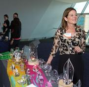 Simon Pearce's Karen Zaratsky with a table full of hardware at the BBJ Best Places to Work breakfast.