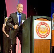 Large company: William Raveis. General Manager Alain Pinel accepted the company's Best Places to Work award in 2011.