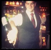 A filtered photo of a bartender pouring a drink at the Russell House Tavern in Cambridge, @russellhousetav on Instagram.