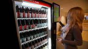 Happy days are here again at Boston's top ad agencies, which are increasing revenue and hiring. Pictured: Arnold Worldwide's robot beer vending machine.
