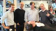 ... and After. Millennium's (from left) Brian Rowley, Nishith Jobanputra, David Hinds and Jeff York celebrate with Jeremiah Genest after he shaved his beard in preparation for the Cambridge biotech's Movember fundraise.