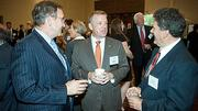 In conversation at the Boston Business Journal's CFO 2012 Awards were from left: Jack Finning of Alexander, Aronson, Finning & Company, Mark Crandall of TD Bank and Paul Martins of Wainwright Investment Counsel. Crandall later took the stage as an award presenter.