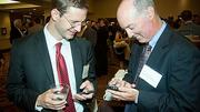 Eric Stahl of Commonwealth Financial Group and Tim O'Connor of Edelstein & Company cyber network at the Boston Business Journal's CFO 2012 Awards.