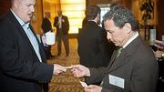 Exchanging business cards at the 2012 CIO of the Year hosted by Mass High Tech and the Boston Business Journal prior to the awards were Tom Finn of Brine Group Staffing Solutions and Ken Cheo of Winfree Business Growth Advisors.