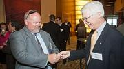 Low-tech business cards were still in play at the 2012 CIO of the Year hosted by Mass High Tech and the Boston Business Journal as demonstrated by honoree Dan Petlon, CIO at Enterasys Networks and David Volin of Maine & Company.