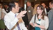 Suffolk Construction's Prinya Pinyochon and Nicole Mills in discussion at the 2012 CIO of the Year hosted by Mass High Tech and the Boston Business Journal.