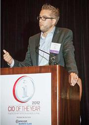 Dries Buytaert, CTO and founder of Acquia accepts his award in the emerging company category at the 2012 CIO of the Year hosted by Mass High Tech and the Boston Business Journal.
