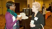 Boston Private Bank & Trust co-workers Michelle Samuel and Robin Assaf have a morning coffee during the networking session at the Boston Business Journal's Top 100 Women-Led Businesses breakfast held at the Boston Sheraton.