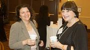 Cathy Copeland of Copeland Art & Design and honoree Cece Newman of D & R Products chat over morning coffee during the networking session at the Boston Business Journal's Top 100 Women-Led Businesses breakfast held at the Boston Sheraton.