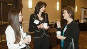 Infinity Pharmacuticals' Jennifer Proctor and Judit Bartis listen to Wende Malster of Gatti & Associates during the networking session at the Boston Business Journal's Top 100 Women-Led Businesses breakfast held at the Boston Sheraton.