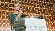 Andrea Cohen, CEO and founder of Houseworks, introduces the first presenting partner of the awards presentation at the Boston Business Journal's Top 100 Women-Led Businesses breakfast, Mindy McGinn, Vice President of Wealth Management at Morgan Stanley.