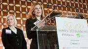Amy Mizner of Benoit Mizner Simon accepted with her colleagues the Small Company Growth award at the Boston Business Journal's Top 100 Women-Led Businesses breakfast.