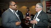 40 Under 40 honoree Louis Mercedes (left) of Edwards Wildman Palmer speaks with Ed Doherty of The March of Dimes, which was the BBJ's nonprofit partner for the night's event.