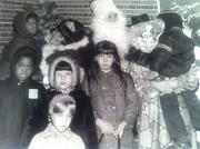 The Jordan Marsh Christmas Caravan visited the Cambridge Neighborhood Center in December, 1970. Santa, the Magic Princess and Winky the Clown extended holiday greetings to Sam Coleman, Michael Coleman, Kathleen Young, John Young, Lavone Young and Jimmy Johnson, all of Cambridge.