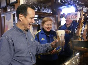Boston Beer founder Jim Koch, Boston Athletic Association President Joann Flaminio, and four-time Boston Marathon champion Bill Rodgers tap the first keg of Samuel Adams Boston 26.2 Brew at the Hampshire House in Boston on Wednesday.