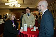 RCN's Laurie DeJongh shares a laugh over coffee with the MFA's Zachary Dollar and Andrew Russell during the social hour prior to the Boston Business Journal's 2013 Most Admired Companies, CEOs & Brands luncheon at the Sheraton Boston Hotel.