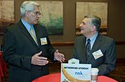 Doing as the sign says, Michael DeVita Jr. of Securadyne Systems and Staples Joe Mazzulo network during the social hour prior to the Boston Business Journal's 2013 Most Admired Companies, CEOs & Brands luncheon at the Sheraton Boston Hotel. NSK Inc was the hours networking sponsor.