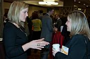 Jill Forchielli of Caesar's Entertainment and Stephanie Kohn of PTC chat during the social hour prior to the Boston Business Journal's 2013 Most Admired Companies, CEOs & Brands luncheon at the Sheraton Boston Hotel. Caesar's was one of the event partners.
