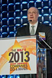 Accepting an award for Most Admired Hotels at the BBJ's 2013 Most Admired Companies, CEOs & Brands luncheon was general manager of The Mandarian Hotel Alain Negueloua.