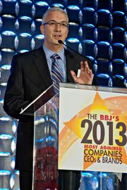 """Robert Hughes, president of worldwide operations of Akamai Technologies accepted one of the BBJ's Most Admired Awards for publicly traded companies by commenting on their growth and stating: """"We're hiring, we need 300 employees in Cambridge right now!"""""""