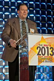 Constant Contact's senior vice president Ken Surdan accepted he BBJ's Most Admired Award for publicly traded companies at the Boston Business Journal's 2013 Most Admired Companies, CEOs & Brands luncheon.