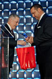 Bill Bacic, New England managing partner at Deloitte accepts his award and Strega gift bag from BBJ publisher Chris McIntosh for Most Admired Accounting Firms at the Boston Business Journal's 2013 Most Admired Companies, CEOs & Brands luncheon. Bacic stated winning three years in a row has not gotten old for him.