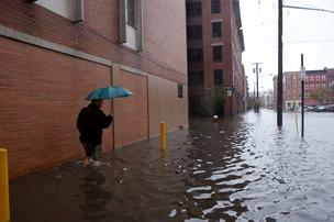 Scenes like this one, from Hoboken, N.J., on Oct. 30 a day after Sandy hit, could be common if a similar storm hits Boston at high tide, according to a Boston Harbor Association report.