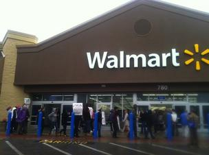 Union members and community organizers protest at a Walmart store in Lynn today.
