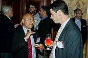 Year Up's Jabes Rojas and Commonwealth Finacial's John Maggioni in conversation during the social portion preceding the awards at the Boston Business Journal's Best Places to Work event.