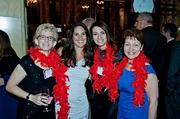Showing solidarity with their red boas at the Boston Business Journal's Best Places to Work event were EBS Capstone's Mim Minichiello, Josie Martinez, Lisa Graziano and Sandra O'Neil.